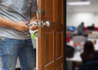 commercial locksmith fixing office door